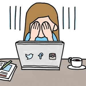 An animated girl sitting in front of a laptop with social media logos on it crying.